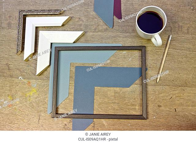 Still life of frames and coffee in picture framers workshop