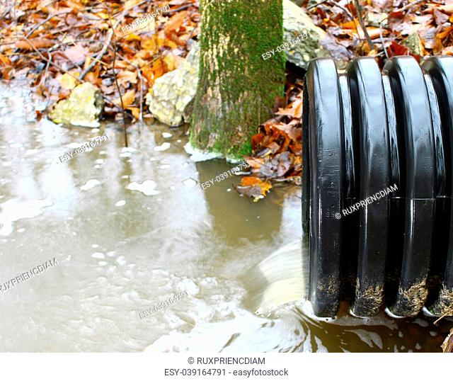 A waste water drainage pipe re-routing the water flow and polluting the environment at the same time