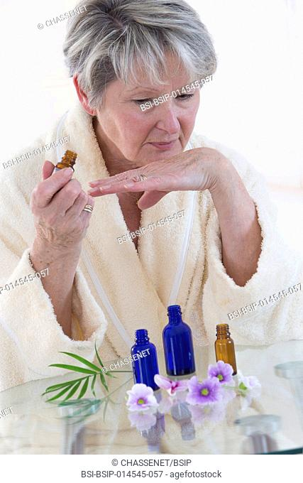A woman smelling essential oils