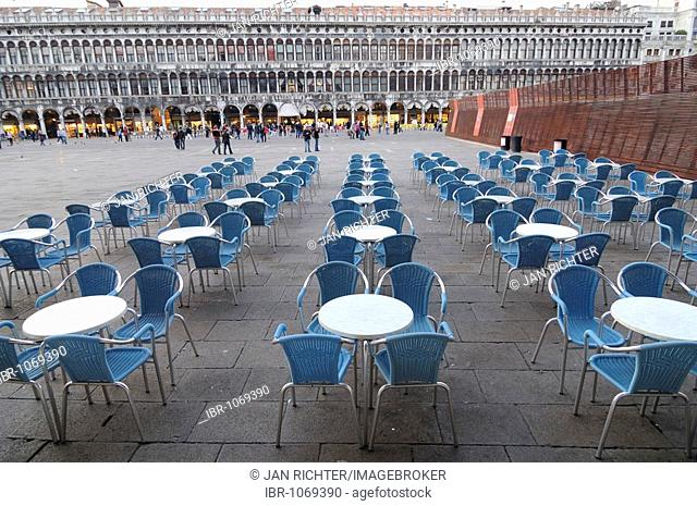 Deserted bistro tables on St. Mark's Square, Venice, Italy, Europe