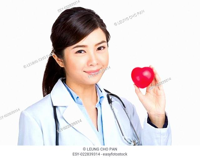 Medical female doctor with heart shape ball