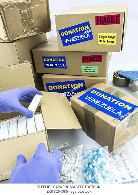 Humanitarian aid, nurse placing boxes with medication to send Venezuela, conceptual image
