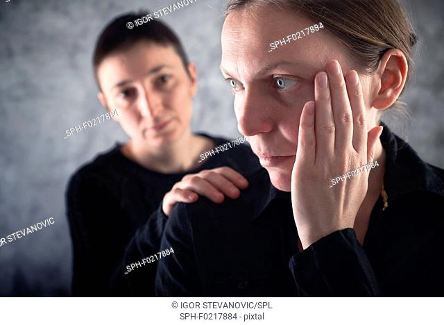 Woman consoling upset friend