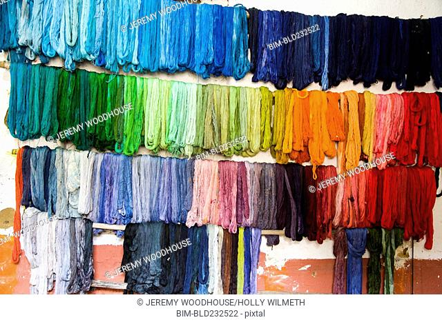 Dyed fabric hanging on wall