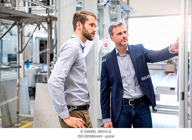 Businessmen in factory having discussion