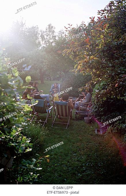 Family having dinner in a garden, Sweden