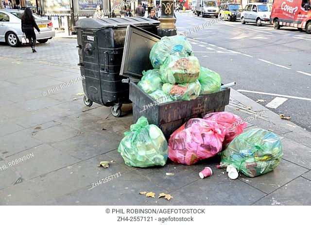 London, England, UK. Rubbish overflowing in the street