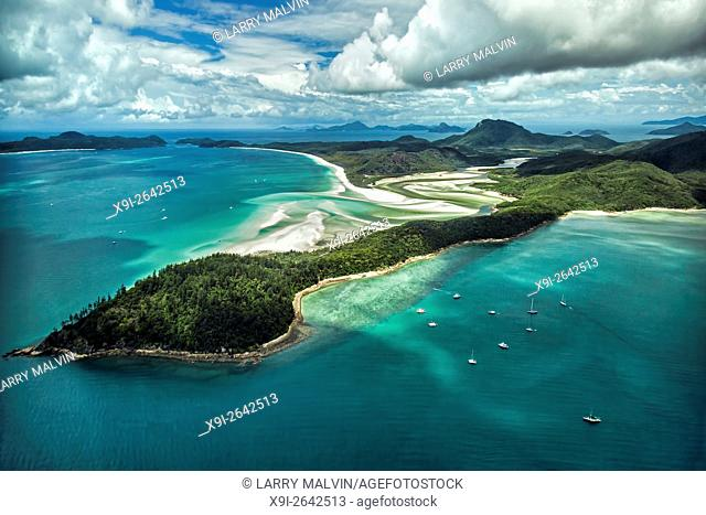 Aerial view from Hill Inlet of the waters and swirling sands of Whitsunday Island with Whitehaven Beach in the distance in Queensland, Australia