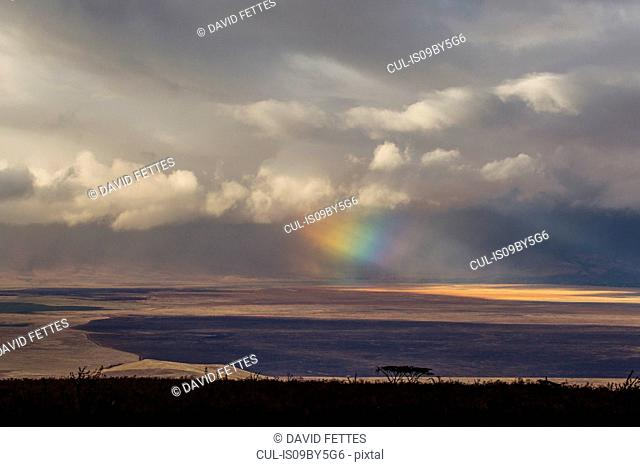 Landscape with storm clouds and rainbow light beams, Ngorongoro Crater, Ngorongoro Conservation Area, Tanzania