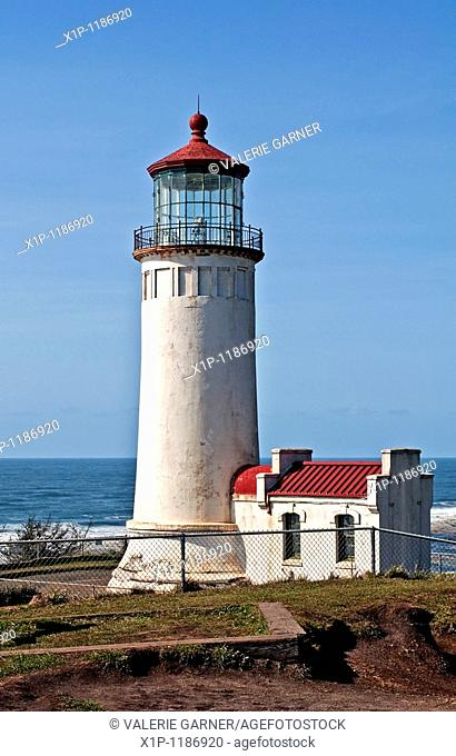 This is the North Head lighthouse off the Pacific ocean in Washington state in Pacific County, with a bright clear blue sky Beautiful lantern room is at the top...