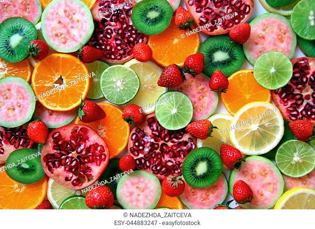 Mixed ripe and fresh fruits and berries close up for background