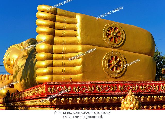 Giant gold reclining sleeping Buddha statue near Wat That Luang temple,Vientiane,Laos,Southeast Asia