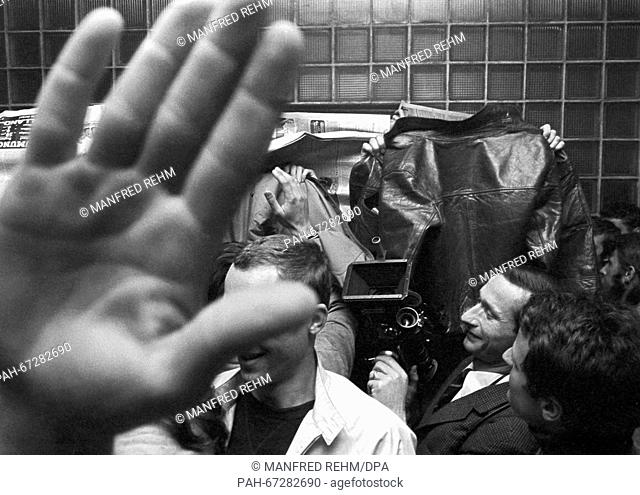 Newspapers, hands and coats which were held up should hinder photographers to document who was involved in charging the rectorate of Frankfurt University on 27...