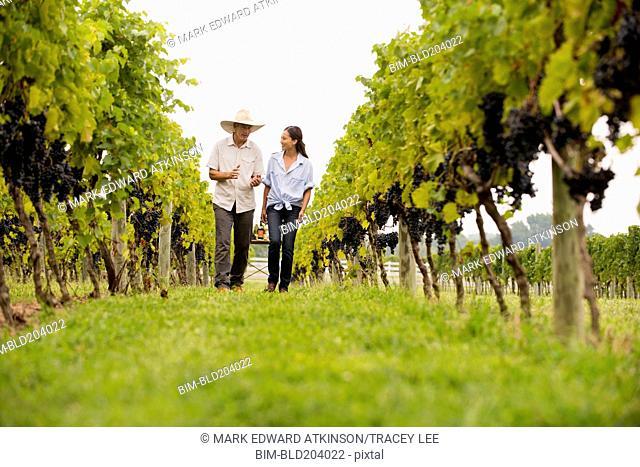 Farmers talking in vineyard