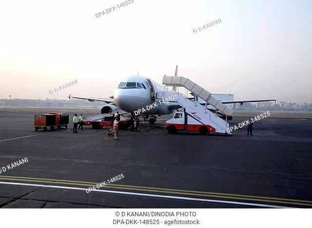 Indian airline's flight is preparing to take off on runway at Chattrapati Shivaji Terminal ; Santacruz ; Bombay now Mumbai ; Maharashtra ; India