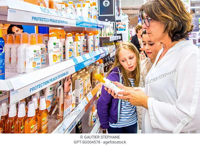BUYING SUNSCREEN AT A SUPERMARKET