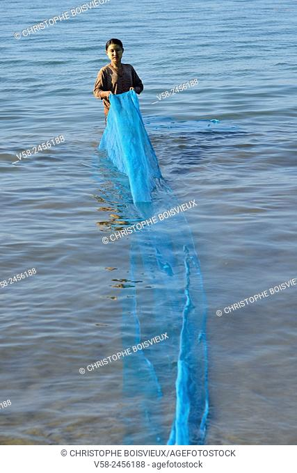 Myanmar, Rakhine State, Ngapali surroundings, Lon Tha bay, Woman washing a net