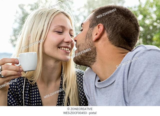 Kissing couple in love in the morning