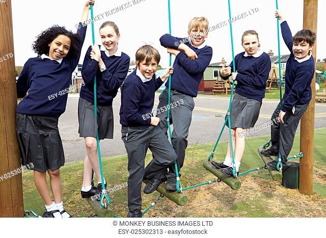Portrait Of Elementary School Pupils On Climbing Equipment