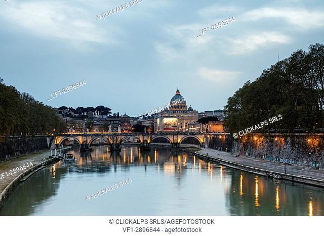 Dusk lights on Tiber River with bridge Umberto I and Basilica di San Pietro in the background Rome Lazio Italy Europe