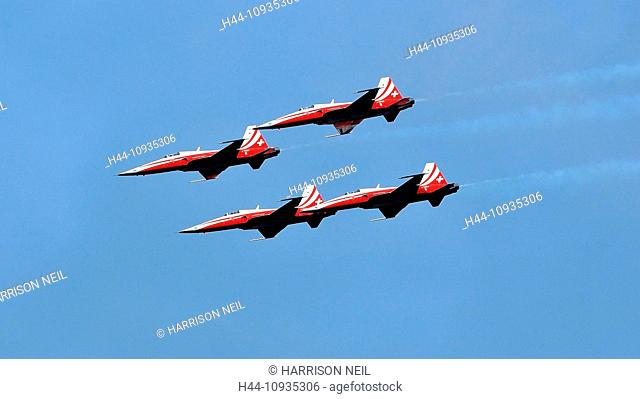 SION, SWITZERLAND, Swiss Air Force team in formation in a blue sky at the Breitling Air show. September 18, 2011 in Sion, Switzerland