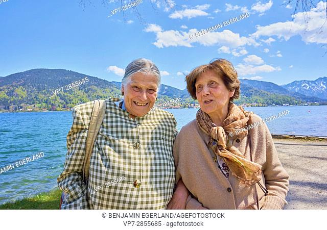 Happy two woman having fun at lake Tegernsee, Bavaria, Germany