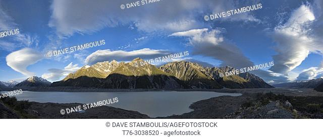 Wild lenticular clouds sail over Lake Tasman and the Southern Alps, New Zealand