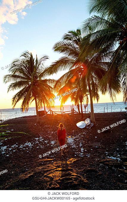 Rear View of Young Girl Walking to Beach at Sunrise, Kona Coast, Hawaii, USA
