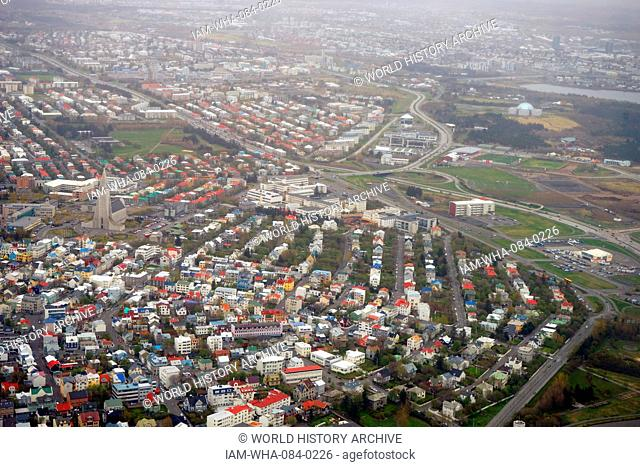 Aerial view of outskirts of Reykjavik, Iceland. Pictured are various types of architecture and some of the colourful buildings. Dated 21st Century