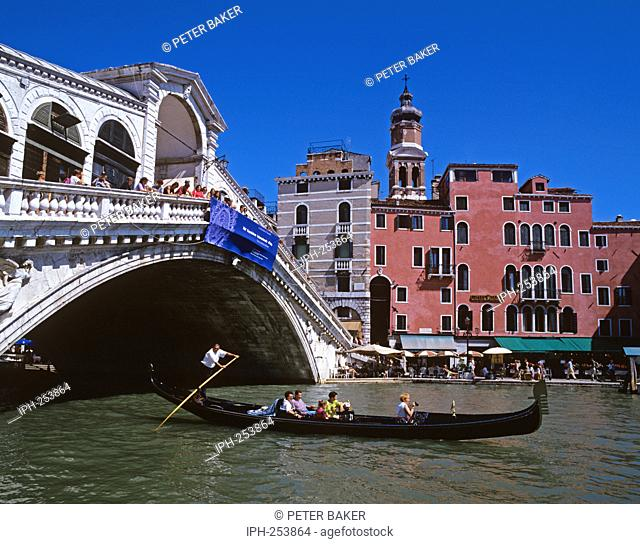 Gondolas passing under Rialto Bridge, the oldest of four bridges that span the Grand Canal in Venice