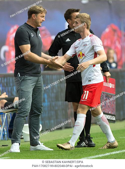 Leipzig's coach Ralph Hasenhuettl (L) takes to Leipzig's Timo Werner at his exchange during the RB Leipzig vs SC Freiburg Bundesliga match in the Red Bull Arena...