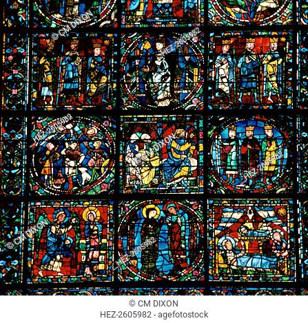 Detail of the Great West Window of Chartres Cathedral. These show the Anunciation, the Vistation, the Nativity, the Shepherds, and the Adoration of the Magi
