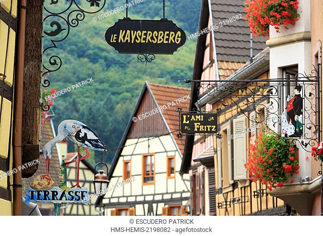 France, Haut Rhin, Route des Vins d'Alsace, Kaysersberg, half timbered facades and restaurant signs