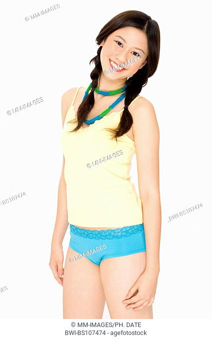 pretty young Asian teenage girl in colorful outfit