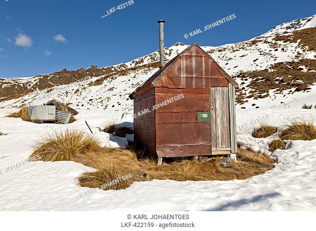 blocked for illustrated books in Germany, Austria, Switzerland: Historical, gold miner's iron hut in snow, pioneers hut in the mountains, near Queenstown