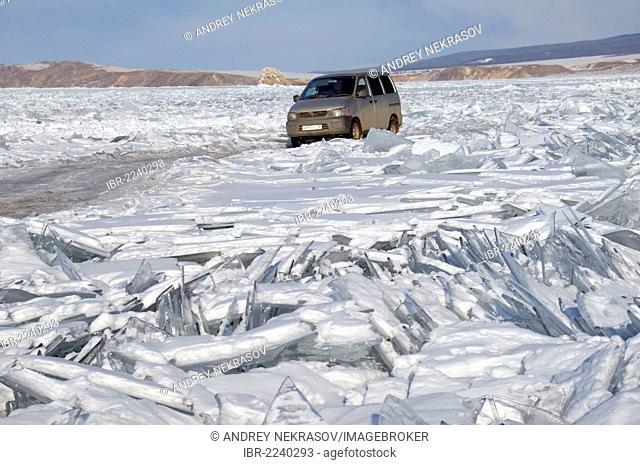 Car on frozen Lake Baikal, Olkhon island, Siberia, Russia, Eurasia