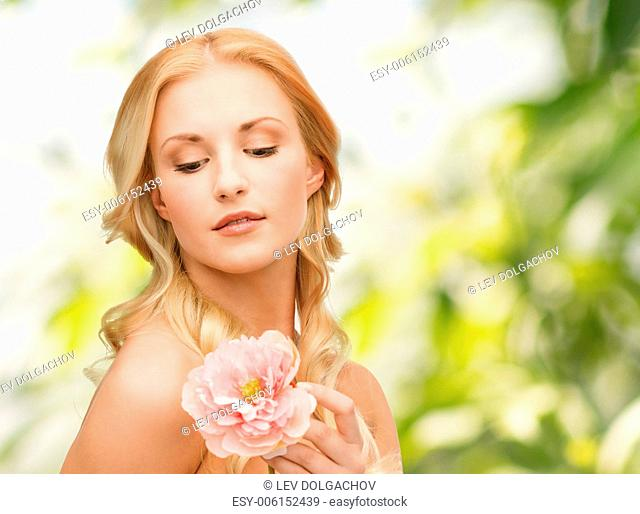 floral and beauty concept - lovely woman with peony flower