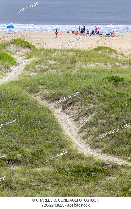 Avon, Outer Banks, North Carolina, USA. Trail Leading over the Dunes of a Barrier Island, to a Family Relaxing on the Beach