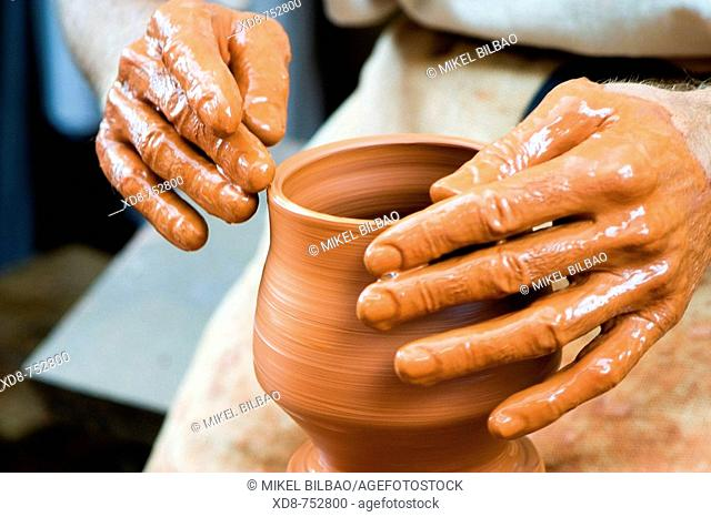 Potter working in a clay pot