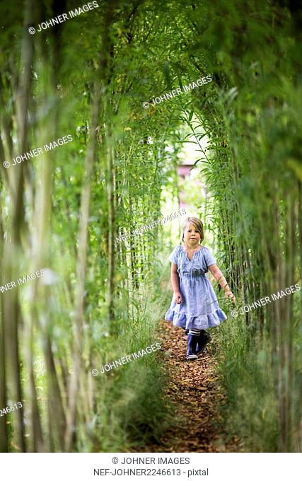 Girl walking among trees