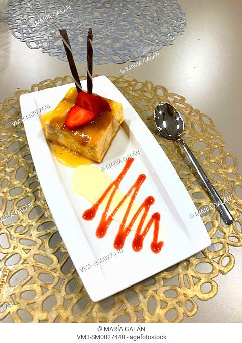 Fruit pudding with strawberry, jam and chocolate sticks