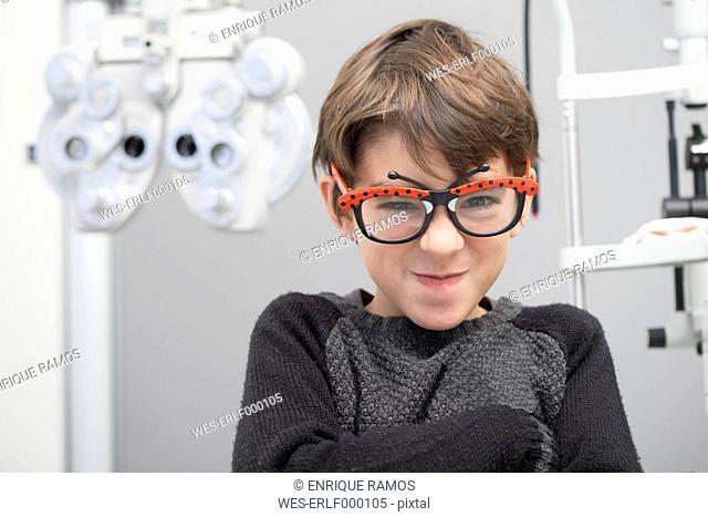 Boy having fun at an optician shop