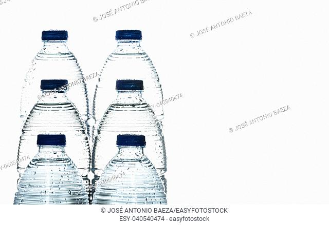fresh mineral water in bottles with free space for text