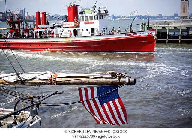 The fireboat John J. Harvey leaves Pier 25 in the Hudson River on a tour. Built in 1931 the boat was retired from the FDNY in 1994
