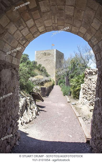 The Espolon Tower viewed through a archway at Lorca Castle in Murcia Spain