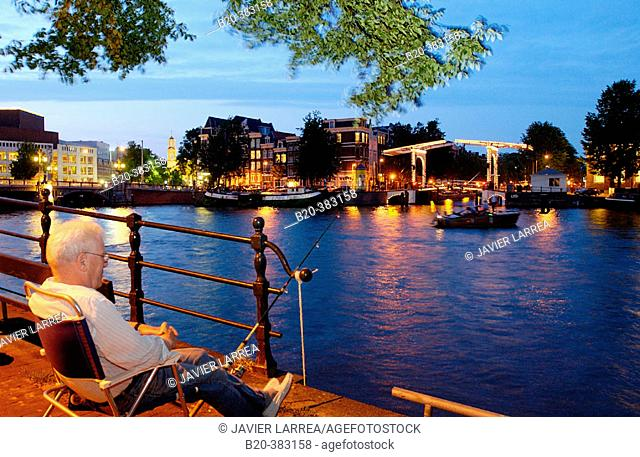 Amstel canal, bridge on new Herengracht. Amsterdam, Netherlands
