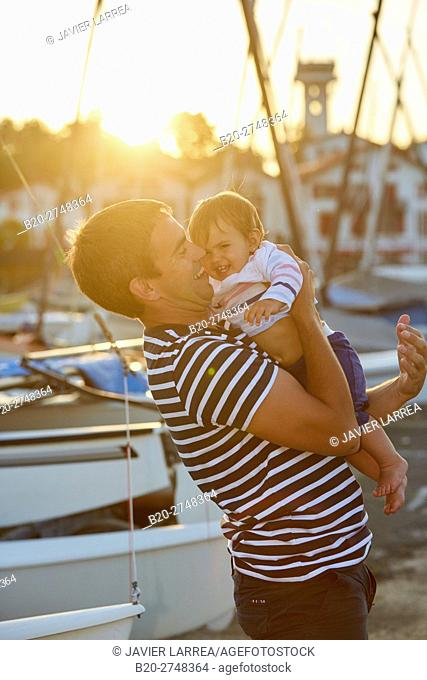 Father playing with baby, Port Socoa, Ciboure, Aquitaine, Pyrenees Atlantiques, France, Europe