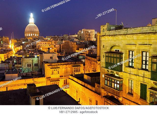 Overview at dusk of illuminated historic city of Valletta, Malta