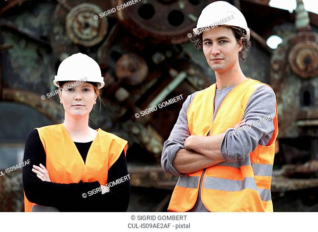 Workers at metal recycling plant