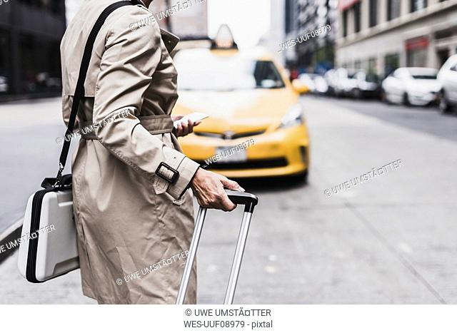 USA, New York City, woman at the roadside